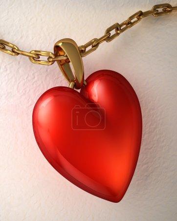 Foto de Colgante corazón rojo brillante, con cadena de oro, colocada sobre un papel blanco. - Imagen libre de derechos