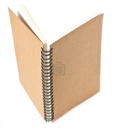 Recycled paper notebook front cover on white background standing.