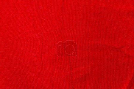 Photo pour Tissu fond textile couleur rouge. Texture de fond tricotée . - image libre de droit
