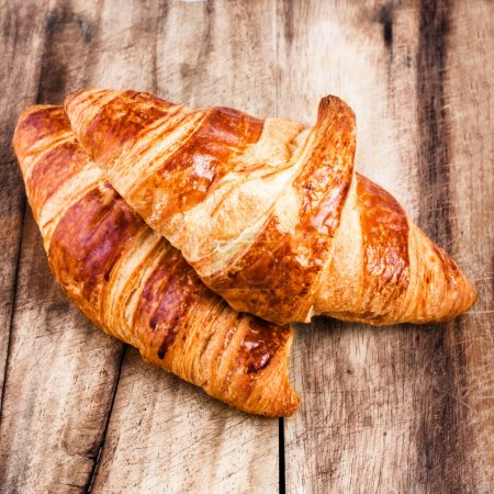 Photo for Fresh Croissants on wooden rustic background - Royalty Free Image