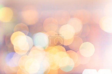 Photo for Defocused Bokeh twinkling lights Vintage background. Festive background with natural bokeh and bright golden lights. - Royalty Free Image