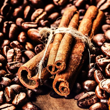Roasted Coffee beans and cinnamon sticks