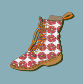 Vector drawing of the shoe with a lace with floral patterns