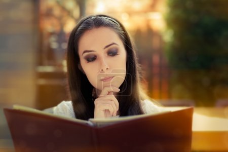 Young Woman Choosing from a Restaurant Menu