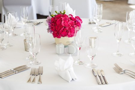 Trio of pink and purple flowers as the centerpiece...