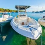 Three boats in Croatia with blue and cyan green wa...