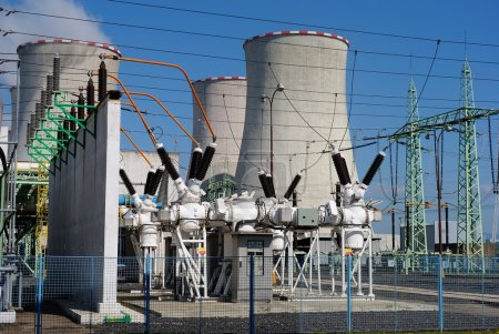 Photo for Transformers and cooling towers in the coal power plant - Royalty Free Image
