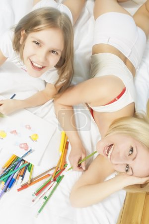 Emotional portrait of young caucasian couple making drawings and