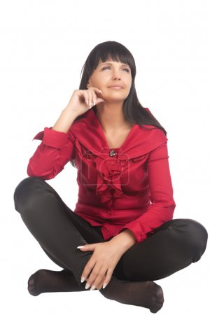 Portrait of Brunette Caucasian Woman Sitting on Fl...
