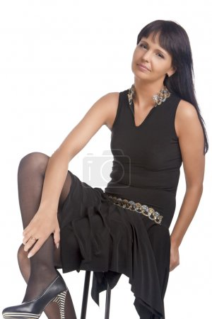 Mid aged Caucasian Brunette Woman Sitting on High ...