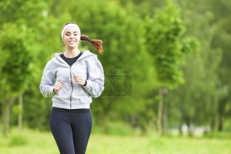Jogging Sport Concept: Young Running Fitness Woman Training Outd