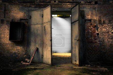 rusty metal door in an abandoned warehouse