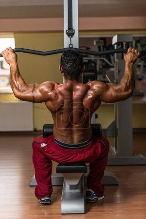 Bodybuilder doing heavy weight exercise
