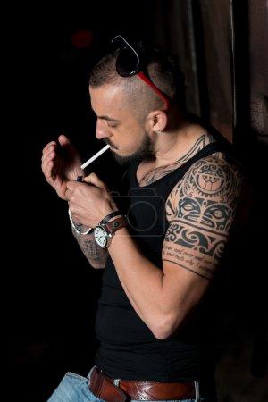 Young Man Firing Up A Cigar