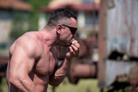 Muscular Man Eating Pancakes