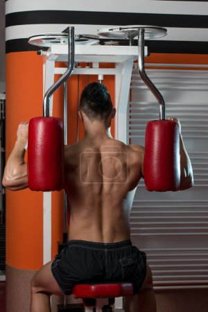 Young Man Doing Exercise For Back