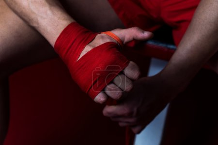 Ultimate Fighter Putting Straps On His Hands