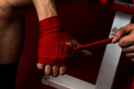 Kick Boxer Putting Straps On His Hands