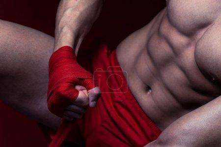 Boxer Putting On Straps Preparing For Combat