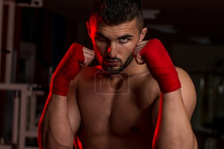Muscular Boxer MMA Fighter Practice His Skills