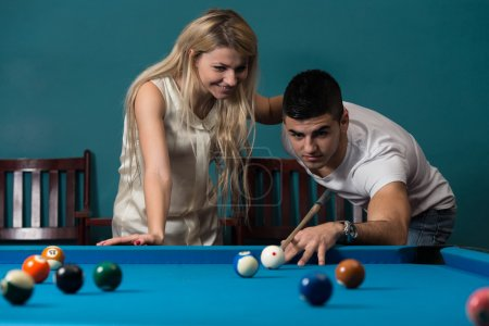 Couple In A Nightclub Playing Pool