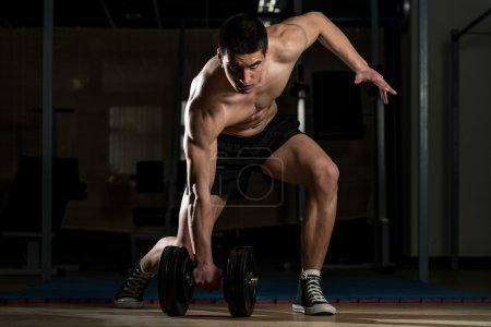 Young Body Builder Lifting Heavy Dumbbell