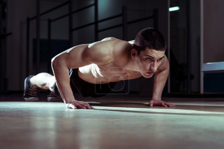 Photo for Young Athlete Doing Push-Ups As Part Of Crossfit Training - Royalty Free Image