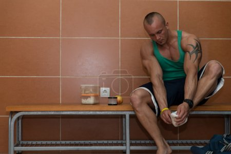 Bodybuilder In Dressing Room - Undressing His Clothing