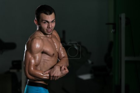 Bodybuilder Performing Side Chest Poses