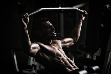 Photo for Young Man Doing Heavy Weight Exercise For Back - Royalty Free Image