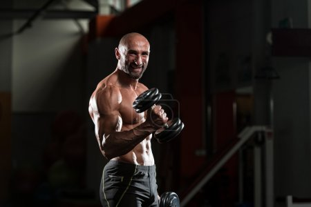 Mature Bodybuilder Working Out Biceps