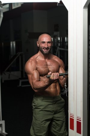 Healthy Man Working Out Biceps In A Health Club