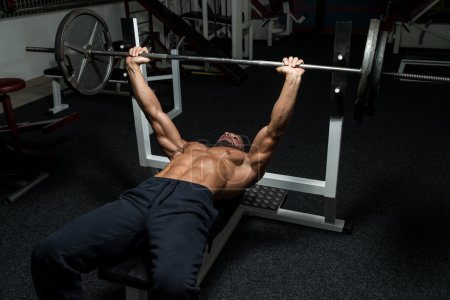 Photo for Mature Man In Gym Exercising On The Bench Press - Royalty Free Image