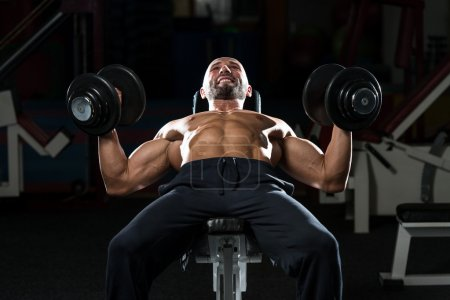 Mature Man Doing Dumbbell Incline Bench Press Workout