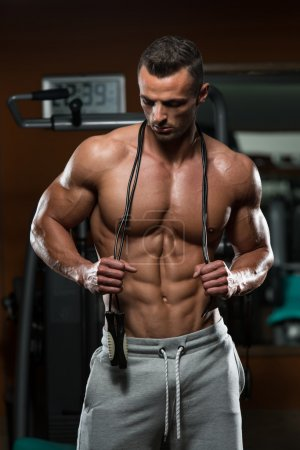 Photo for Handsome Muscular Man With Jumping Rope - Cardio Time - Royalty Free Image
