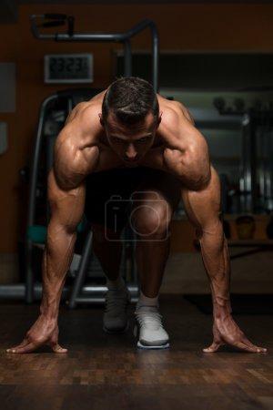 Strong Muscular Men Kneeling On The Floor