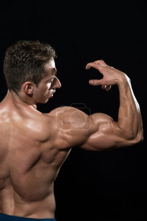 Bodybuilder Showing Biceps