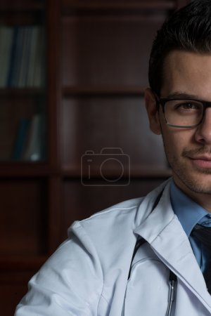 Portrait Half Of Face Of Young Doctor