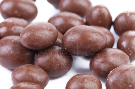 Dark brown dragee in chocolate covered