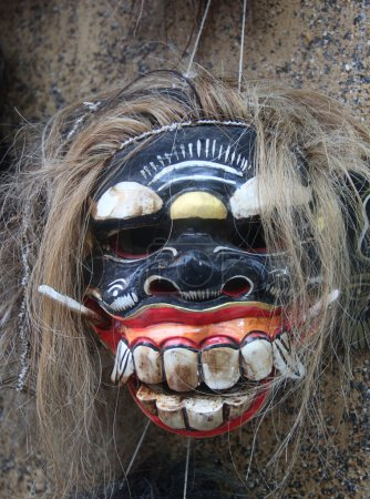 Wooden figure face. Old traditional mask...