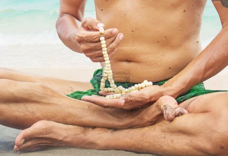 Man meditating on the beach
