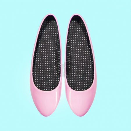 Pink shoes on a blue background