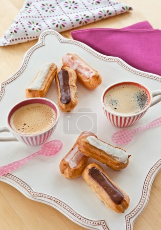 Coffee and little eclairs