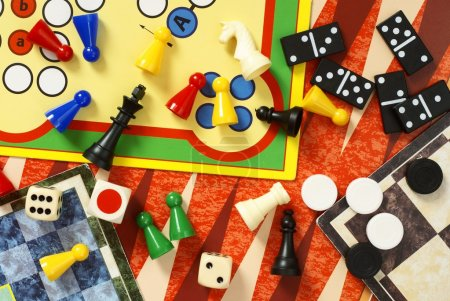 Photo for Top view of board games, pawns, chessmen, dominoes and dices - Royalty Free Image