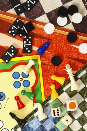 Photo for Top view of board games, pawns, chessmen, dominoes and dices. - Royalty Free Image