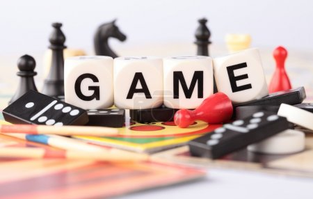 Photo for Detail of board games, pawns, chessmen, dominoes, mikado sticks. - Royalty Free Image