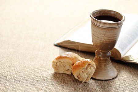 Communion still life - wine, bread and Bible...