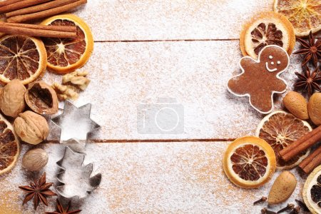 Photo for Top view of wooden board with Christmas baking ingredients. - Royalty Free Image