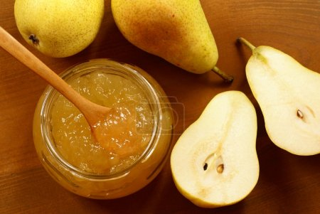 Pear jam in glass and pears.