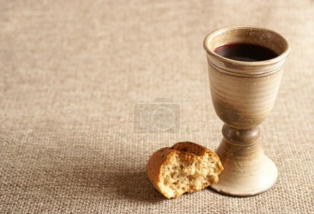 Chalice with wine and bread. Background with copy ...